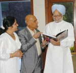 "Music Director Khayyam presenting a book titled ""Khayyam: The man, His Music' to Prime Minister, Dr. Manmohan Singh, in New Delhi on July 7, 2006 (Pic courtesy: PIB)"